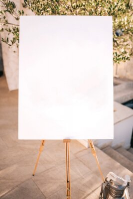 Bild Wooden easel with white paper
