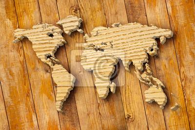 Bild: World map carving on wood plank