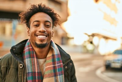 Bild Young african american man smiling happy standing at the city