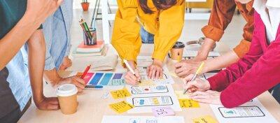 Bild Young Asian business creative team work together, mobile application software design project. Brainstorm meeting, internet technology, smartphone web app designer, office coworker teamwork concept
