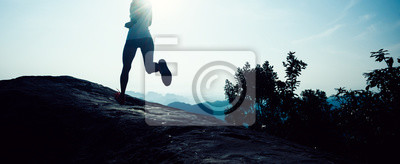Bild young fitness woman trail runner running to mountain top