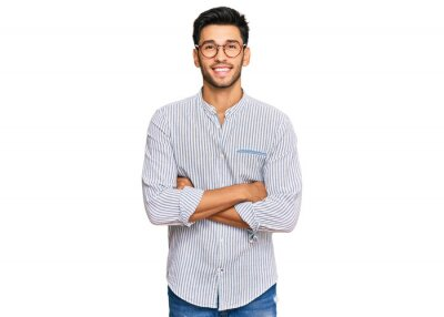 Bild Young handsome man wearing casual clothes and glasses happy face smiling with crossed arms looking at the camera. positive person.