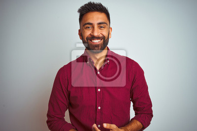 Bild Young indian man wearing red elegant shirt standing over isolated grey background with hands together and crossed fingers smiling relaxed and cheerful. Success and optimistic