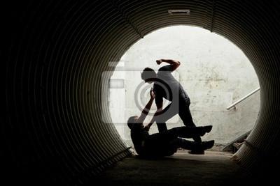 Bild Young man being mugged in a dark tunnel