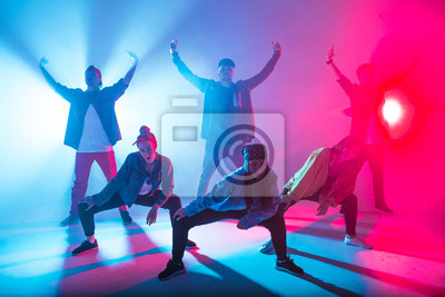 Bild Young modern dancing group of six adult young people practice dancing on colorful background