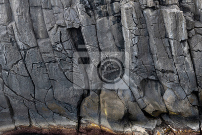Fototapete Abstract black lave basalt rock formation walls at the Ponta do Mistério on Terceira Island, Azores