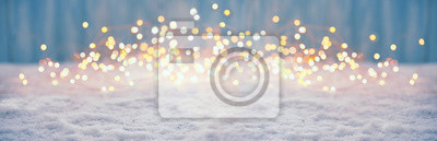 Fototapete Abstract magic winter landscape with snow and golden bokeh lights - Banner, Panorama
