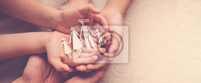 Fototapete Adult and children hands holding paper family cutout, family home, foster care, homeless support concept