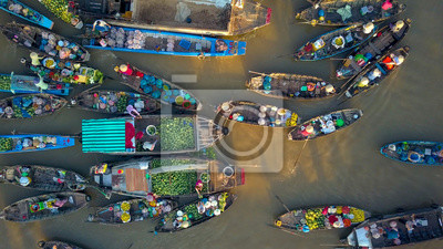 Fototapete AERIAL: Local people buying and selling colorful produce from wooden boats.