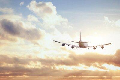 Fototapete airplane in sunset sky