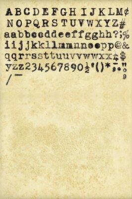 Alphabet aus Vintage-Schreibmaschine und verwitterten Papier