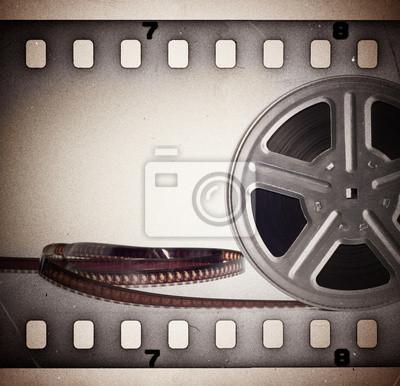 Alte Kinofilmrolle mit Filmstreifen. Vintage-Hintergrund