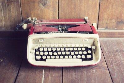 Fototapete Alte Schreibmaschine auf einem Holzboden