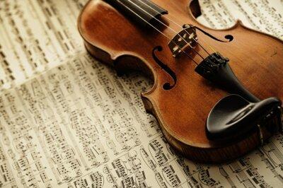 Fototapete alte und seltene Geige auf einem Notenblatt