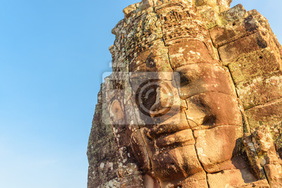 Fototapete Amazing view of giant stone face of Bayon temple, Angkor
