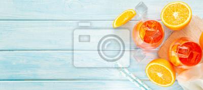 Fototapete Aperol and ingredients drinks on wood background, copy space