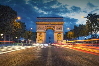Fototapete Arc de Triomphe. Image of the iconic Arc de Triomphe in Paris city during twilight blue hour.