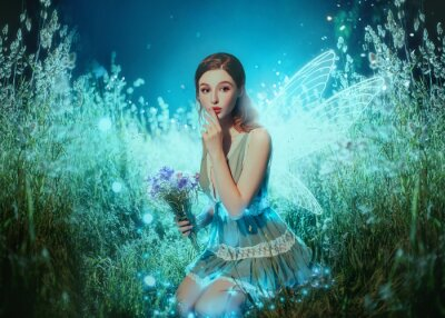 Fototapete Art photo fantasy pixie butterfly. young fairy with glow wings holds bouquet flower. dark blue backdrop fabolous night Firefly star glitter light. Fingers show sign silence. cute face, makeup red lips