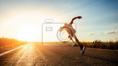 Fototapete Athlete runner feet running on road