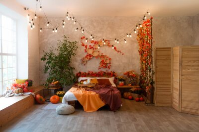 Fototapete Autumn bedroom, living room interior. Red and yellow leaves and flowers in the vase and pumpkin on light background.