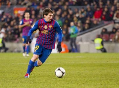Fototapete BARCELONA -   Lionel Messi in action during the Spanish Cup match between FC Barcelona and Valencia CF, final score 2-0,  in Camp Nou stadium, Barcelona, Spain