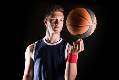 Fototapete Basketball-Spieler drehender Ball auf dem Finger