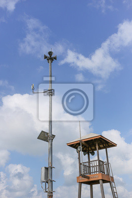 Beach Guard, Lifesaver patrol tower with cloud blue sky.