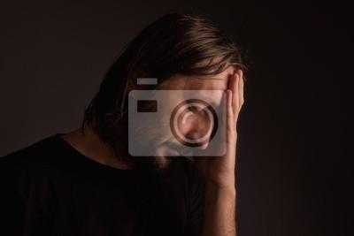 Fototapete Bearded adult man with migraine headache