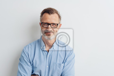 Fototapete Bearded middle-aged man wearing glasses