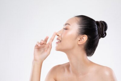 Fototapete Beautiful Asian woman touching nose smile with clean and fresh skin Happiness and cheerful with positive emotional,isolated on white background,Beauty and Cosmetics Concept