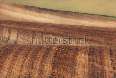 Fototapete Beautiful concept landscape with striped fields of South Moravia at sunset, abstract background