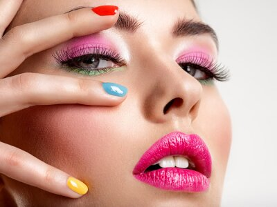Fototapete Beautiful fashion woman with a colored nails. Attractive white girl with multicolor manicure.