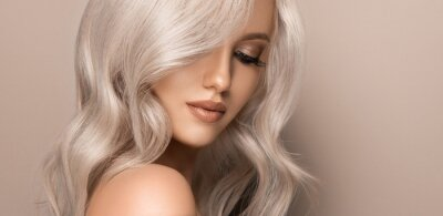 Fototapete Beautiful girl with hair coloring in ultra blond. Stylish hairstyle curls done in a beauty salon. Fashion, cosmetics and makeup