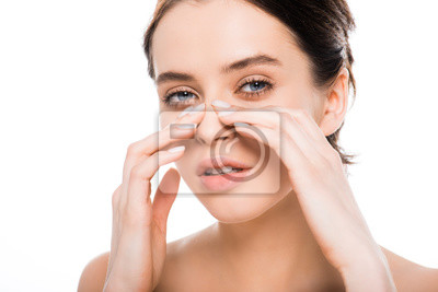 Fototapete beautiful nude woman touching nose after rhinoplasty and looking at camera isolated on white