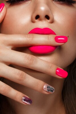 Fototapete Beautiful young woman with bright makeup and neon pink nails. Beauty face. Photo taken in the studio