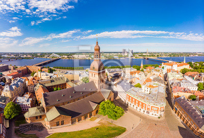 Fototapete Beautifull aerial panoramic view from drone In sunny summer Day to histirical center Riga and quay of river Daugava. Famous Landmark - City Dome Cathedral church and Old Town Monument. Latvia, Europe.