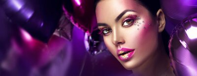 Fototapete Beauty fashion model girl creative art makeup with gems. Woman face over purple, pink and violet air balloons background