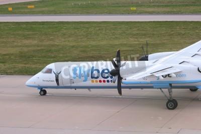 Fototapete BIRMINGHAM, UK - APRIL 24, 2013: Pilots taxi Flybe Bombardier Dash 8 Q-400 at Birmingham Airport, UK. Flybe carried 7.6 million passengers in 2013.