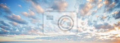 Fototapete Blue sky clouds background. Beautiful landscape with clouds and orange sun on sky