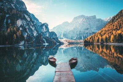 Fototapete Boats on the Braies Lake ( Pragser Wildsee ) in Dolomites mountains, Sudtirol, Italy