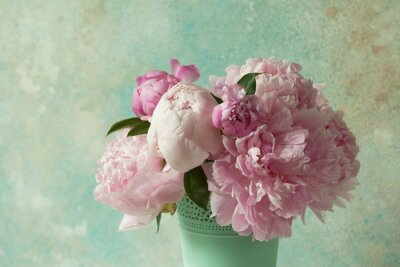 Fototapete Bouquet of pink peonies in a vase on a light colored background