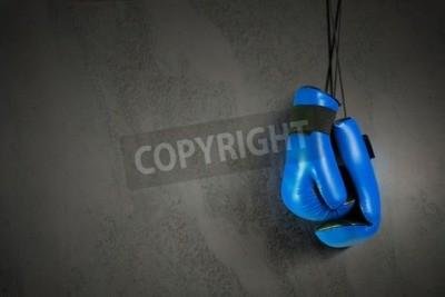 Fototapete Boxhandschuhe hängen am Nagel an der Wand