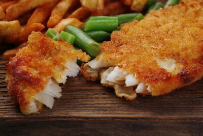 Fototapete Breaded fried fish fillet and potatoes with asparagus