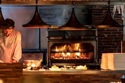 Fototapete Brennender Grill im Ofen an der Gaststätteküche