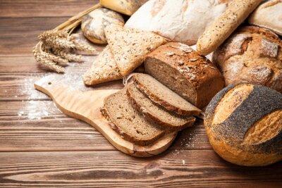 Fototapete Brot Sortiment auf Holzoberfläche