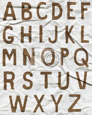 Brown Buchstaben des Alphabets auf zerknittertes Papier
