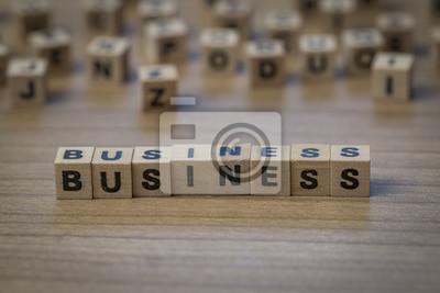 Business in Holzwürfel geschrieben