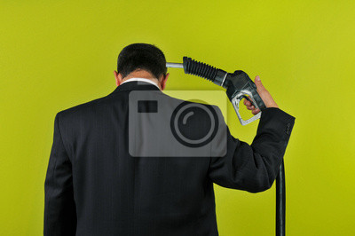 Businessman committing suicide with a gas nuzzle