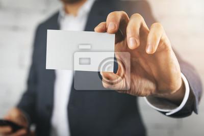 Fototapete businessman hand showing blank white business card closeup