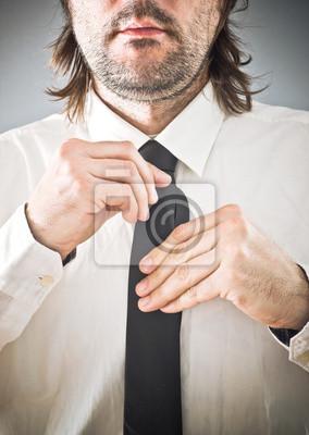 Fototapete Businessman tying necktie